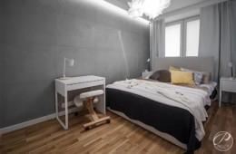 szara sypialnia, beton na ścianie, podłoga drewniana