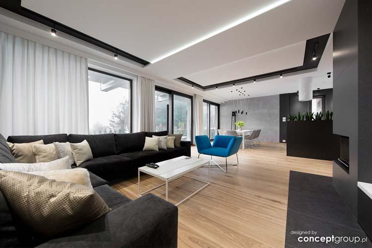 saolon, niebieski fotel, czarna sofa narożna