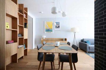 Jadalnia z drewnianym stołem i szarymi krzesłami