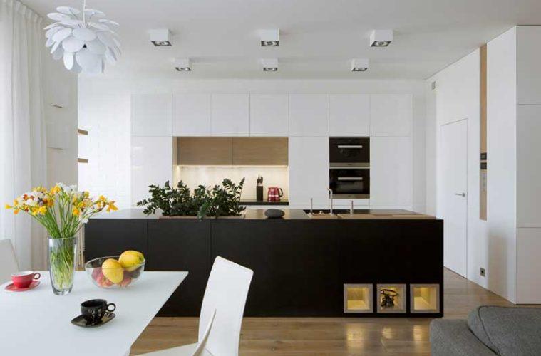 salon z aneksem kuchennym, wyspa z czarnego kamienia