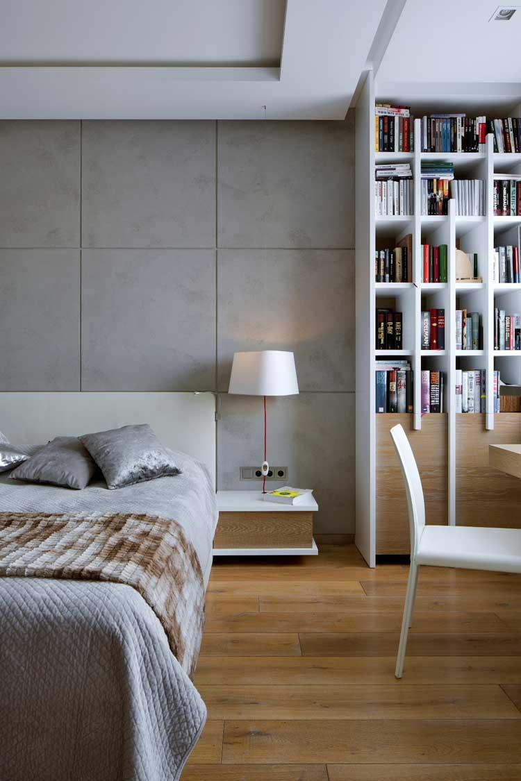 sypialnia, ściana z betonu, biały regał na książki